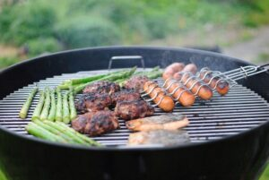 cooking on a grill in a backyard during summer