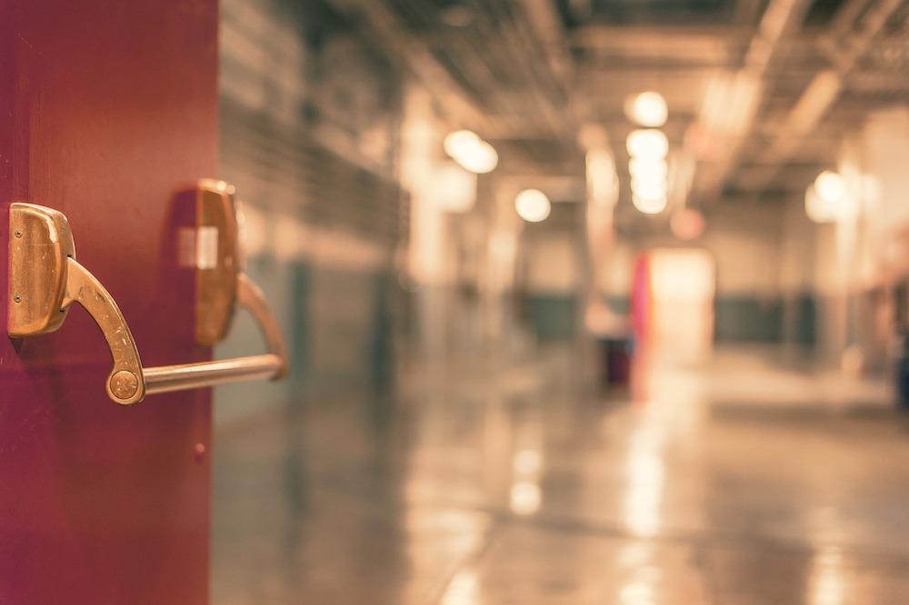 open door with unfocused view down hospital corridor